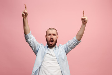 Winning success man happy ecstatic celebrating being a winner. Dynamic energetic image of male model