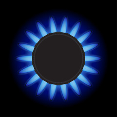 Burning blue flame gas burner on a black background. Top view.