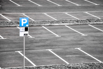 Parking lot with a blue sign