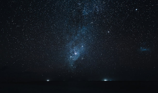 amazing starry sky above ocean at night, Thoddoo island, Maldives