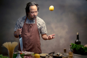 Man cook chef hipster with handsome bearded with a knife.