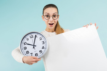 Attractive young woman with blank banner and clock