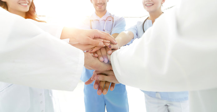 background image of a successful group of doctors on a white bac
