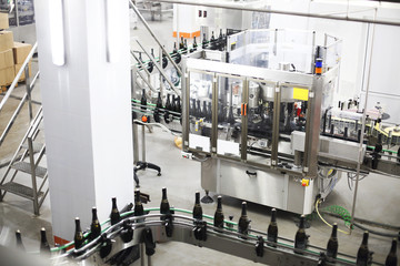 Industrial production shot with champagne bottles
