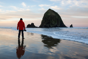 Photographer taking pictures of the beautiful Oregon Coast