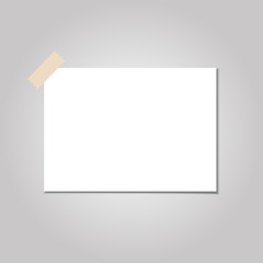 Clear list of paper with sticky tape on a grey background