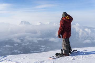 Snowboarder riding Revelstoke Mountain, British Columbia, Canada.