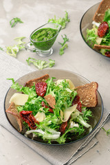 Frisee lettuce salad with sun dried tomatoes