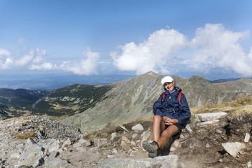 Happy Hiker Woman on the Top of a Mountain with Stunning View