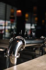 Beer taps at bar counter at the restaurant