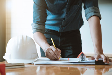 Engineer man working with drawings inspection in workplace in office. Engineering construction concept. architect and Business concept.