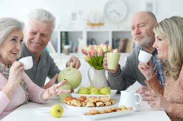 two  Senior couples drinking tea