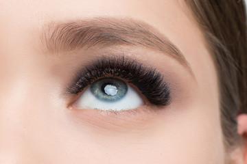 Closeup image of beautiful woman eye with fashion makeup and long eyelashes