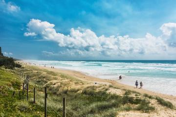 COOLUM, AUSTRALIA, FEB 18 2018: People enjoying summer at Coolum main beach - a famous tourist destination in Queensland