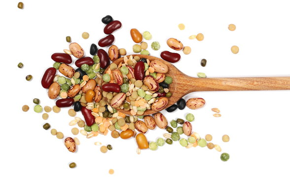 Mixed dried legumes and cereals with wooden spoon isolated on white background