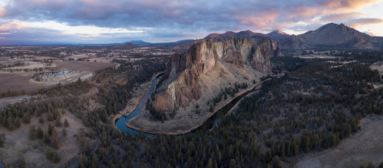 Wall Mural - Aerial panoramic view of a beautiful landmark, Smith Rock, famous for rockclimbing. Taken in Redmond, Oregon, America, during a vibrant sunrise.