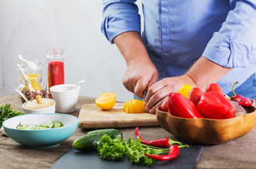 man cooking a vegetarian salad