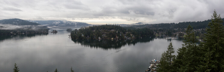Beautiful panoramic view of Deep Cove from the Top of Quarry Rock. Taken in North Vancouver, British Columbia, Canada, during a vibrant winter morning.