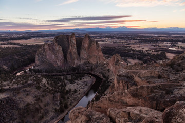 Striking landscape of the famous location, Smith Rock, during a winter cloudy sunset. Taken in Oregon, United States of America.