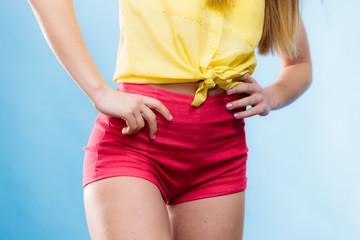 Closeup woman hips in shorts