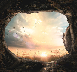 Easter Sunday concept: Empty tomb stone and meadow autumn sunrise background