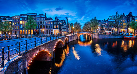 Fototapete - Bridge Blue hour arch over canal in Amsterdam Netherlands.