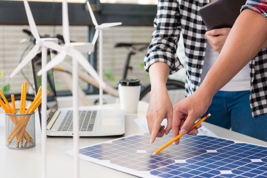 energy engineer pointing to solar power panel