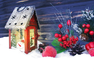 christmas lantern decoration winter berries and snow on wooden background
