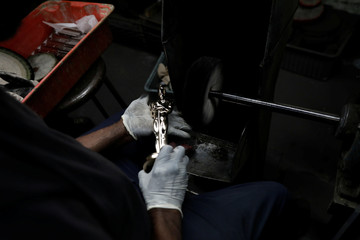 An Oscar statuette is cleaned at Epner Technology in Brooklyn, New York