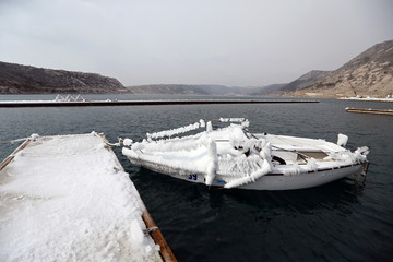 A boat covered in ice is seen in Bakarac