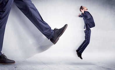 Big leg kicking small man