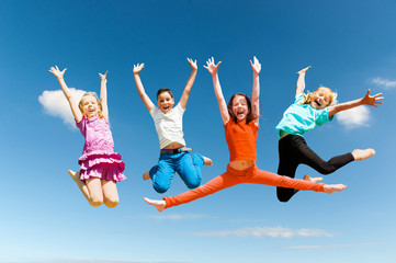 Happy active children jumping