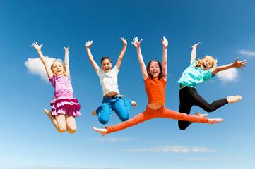 Happy active children jumping Fotoväggar