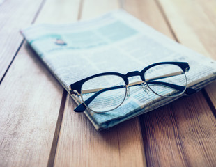 Glasses with Newspaper