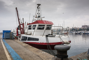 Photograph of a fishing port on a cloudy day. T
