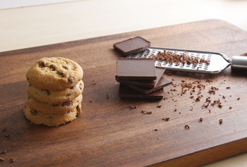 cookies with chocolate on a wooden background