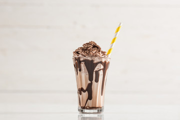 Aluminium Prints Milkshake Chocolate Milk and Whipped Cream on White Background