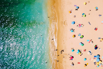 Foto op Plexiglas Luchtfoto Aerial View From Flying Drone Of People Crowd Relaxing On Beach In Portugal