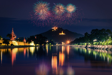 Mandalay hill at night with firework show in Mandalay, Myanmar.