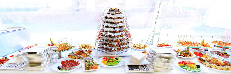 catering table set service with silverware and glass