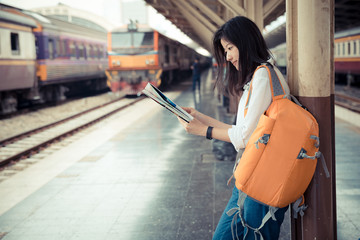 traveler with map at train station