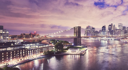 Dumbo neighborhood and the Brooklyn Bridge at night, color toned picture, New York City, USA.