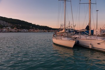 Colorful sunset sky over Zakynthos harbour, Greece.