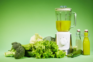 Fresh diet vegetable smoothie on green background