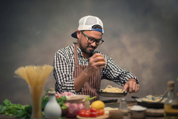 Man cook chef hipster with handsome bearded face in a hat