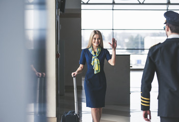 Pilot and flight attendant in airport