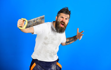 Brutal builder concept. Guy with beard covered with dust.