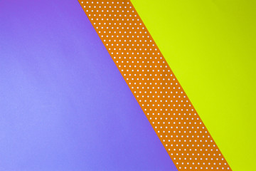 Abstract geometric yellow, purple and polka dot paper background.