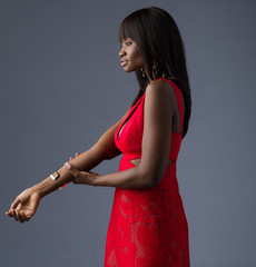 Beautiful African Model Posing in a Red Dress - Three Quarters