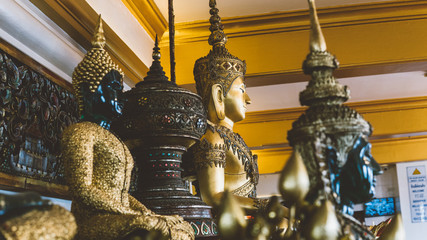Buddhist statues of Buddha in the Thai monastery close-up.  Sacred Symbols of Buddhism
